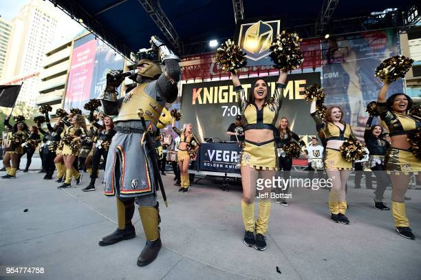The Golden Knight and Vegas Golden Knights cheerleaders rally fans outside the arena prior to Game Five of the Western Conference Second Round...