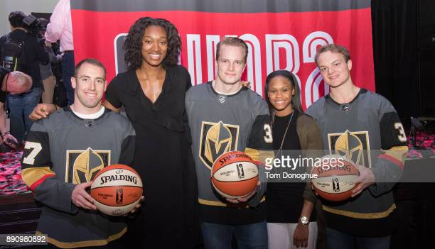 The Golden Knights Brad Hunt Oscar Dansk and Reid Duke pose for a photo with Moriah Jefferson and Kayla Alexander during the WNBA announcement of the...