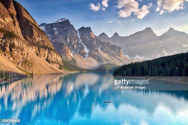 the golden light moraine lake - moraine lake stock pictures, royalty-free photos & images