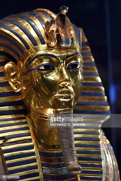 The golden mask of legendary Egyptian boy king Tutankhamun is displayed at the Egyptian Museum in Cairo after its restoration on December 16 2015 The...