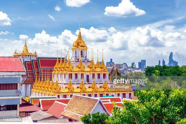 The Golden Metal Castle Loha Prasat of Wat Ratchanadda Temple with Golden Mount of Wat Sraket Temple, Bangkok Thailand
