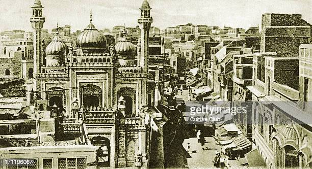 The Golden Mosque in Lahore early 20th century suurounded by bazaars India / Pakistan / Indian Empire Built in 1753 by Nawab Syed Bhikari Khan Bazaar...