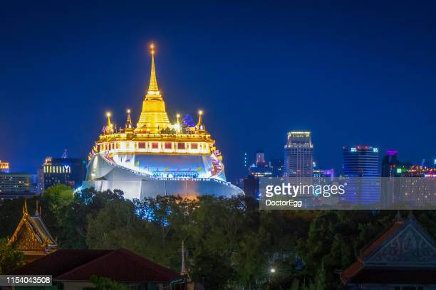 The Golden Mount of Wat Sraket Temple landmark of Bangkok with Skyscraper Buildings Background, Bangkok, Thailand