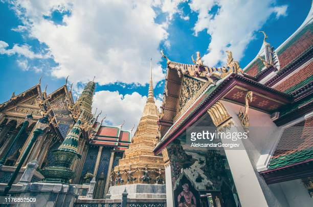 the golden ornaments of the grand palace in bangkok, thailand - association of southeast asian nations stock pictures, royalty-free photos & images