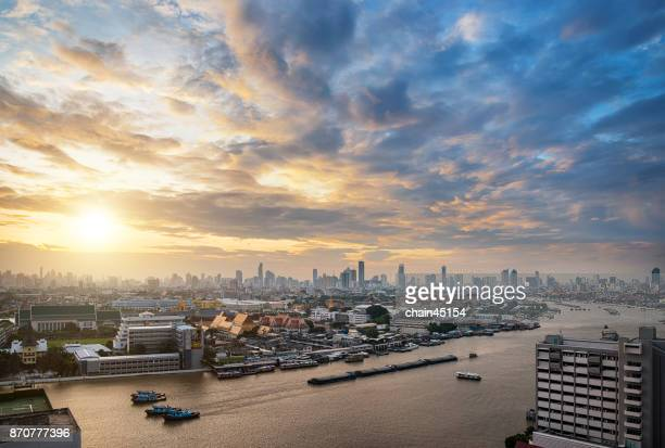 The Golden Royal Grand Palace of Bangkok with Chaophraya river and boat Transportation during sunrise. Favorite landmark of travel destination of asia. Best of amazing beautiful scene of Bangkok Thailand.