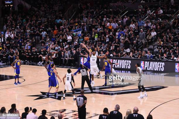 The Golden State Warriors and the San Antonio Spurs tipoff in Game Three of Round One of the 2018 NBA Playoffs on April 19 2018 at the ATT Center in...