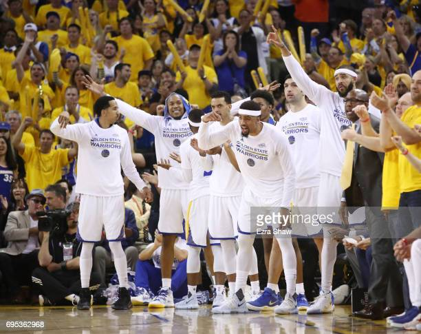 The Golden State Warriors bench celebrates against the Cleveland Cavaliers during the second half in Game 5 of the 2017 NBA Finals at ORACLE Arena on...