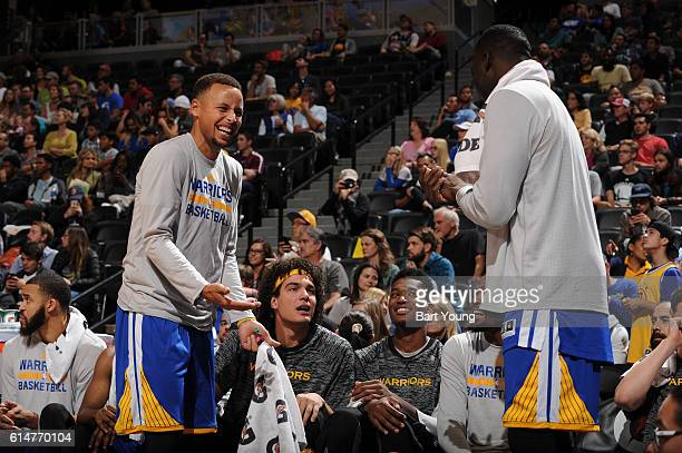 The Golden State Warriors bench smile during a preseason game against the Denver Nuggets on October 14 2016 at the Pepsi Center in Denver Colorado...