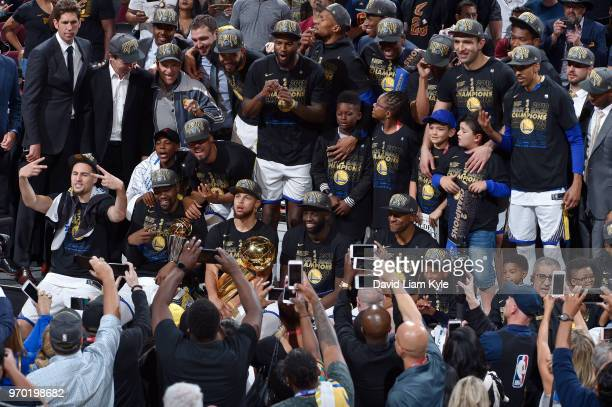 OH The Golden State Warriors celebrate a four game sweep after the game against the Cleveland Cavaliers as they hold the Larry O'Brien NBA...