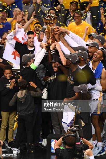 The Golden State Warriors celebrate after defeating the Cleveland Cavaliers in Game Five of the 2017 NBA Finals on June 12 2017 at ORACLE Arena in...