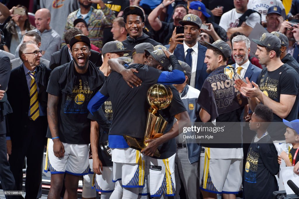 OH - The Golden State Warriors celebrate after the game against the Cleveland Cavaliers as they hold the Larry O'Brien NBA Championship Trophy after Game Four of the 2018 NBA Finals on June 8, 2018 at Quicken Loans Arena in Cleveland, Ohio.