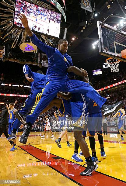 The Golden State Warriors celebrate after winning a game against the Miami Heat at American Airlines Arena on December 12 2012 in Miami Florida