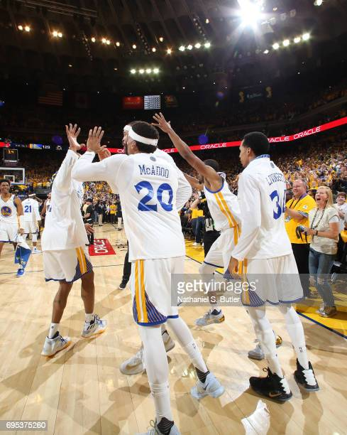 The Golden State Warriors celebrate and run on the court after winning Game Five of the 2017 NBA Finals against the Cleveland Cavaliers on June 12...