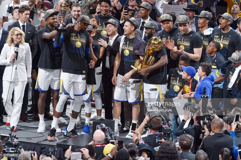 OH - The Golden State Warriors celebrate as Kevin Durant #35 wins the Bill Russell NBA Finals Most Valuable Player Trophy while the team holds the Larry O'Brien NBA Championship Trophy in Game Four of the 2018 NBA Finals on June 8, 2018 at Quicken Loans Arena in Cleveland, Ohio.