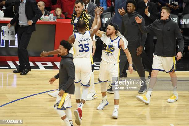 The Golden State Warriors celebrate during Game Four of Round One of the 2019 NBA Playoffs on April 21 2019 at STAPLES Center in Los Angeles...