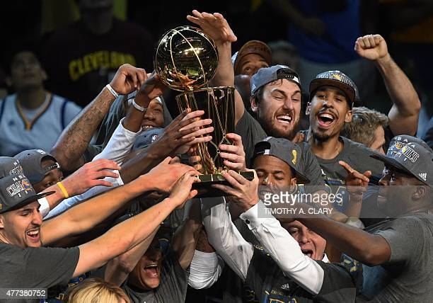 The Golden State Warriors celebrate winning the 2015 NBA Finals on June 16, 2015 at the Quicken Loans Arena in Cleveland, Ohio. Steph Curry and Andre...