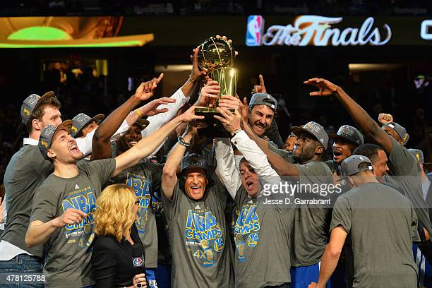 The Golden State Warriors celebrate winning the Larry O'Brein Trophy in Game Six of the 2015 NBA Finals against the Cleveland Cavaliers at The...