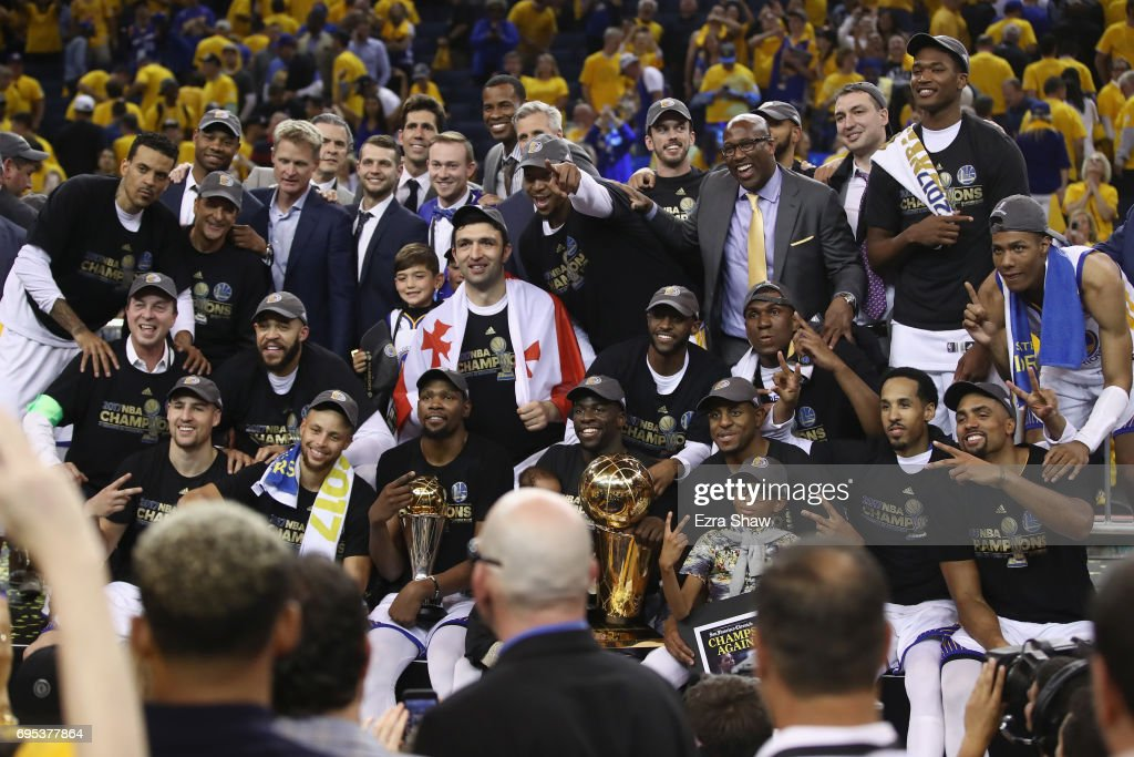 The Golden State Warriors celebrate with the Larry O'Brien Championship Trophy after defeating the Cleveland Cavaliers 129-120 in Game 5 to win the 2017 NBA Finals at ORACLE Arena on June 12, 2017 in Oakland, California.