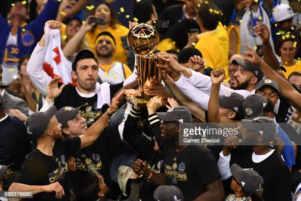 The Golden State Warriors celebrate with the Larry O'Brien trophy after defeating the Cleveland Cavaliers in Game Five of the 2017 NBA Finals on June...