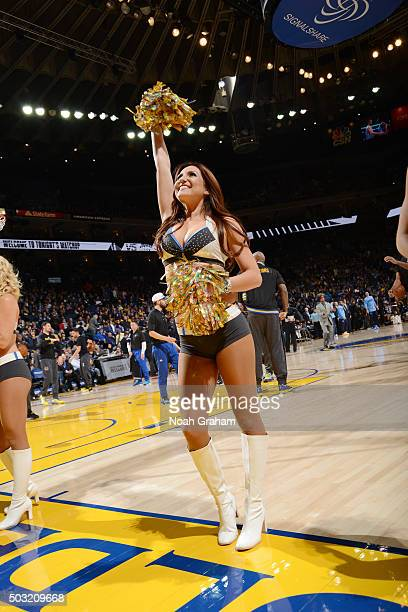 The Golden State Warriors cheerleaders perform before the game against the Denver Nuggets on January 2 2016 at ORACLE Arena in Oakland California...