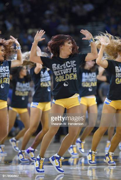 The Golden State Warriors Dance Team celebrating Black History month performs in tshirts that read Black History Is Golden during an NBA basketball...