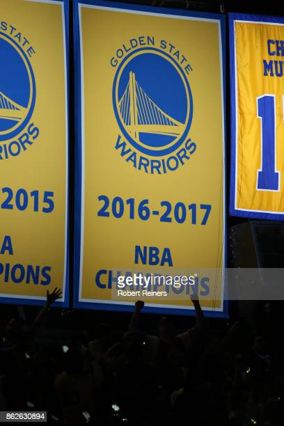 The Golden State Warriors display their 2017 NBA Championship banner prior to their NBA game against the Houston Rockets at ORACLE Arena on October...