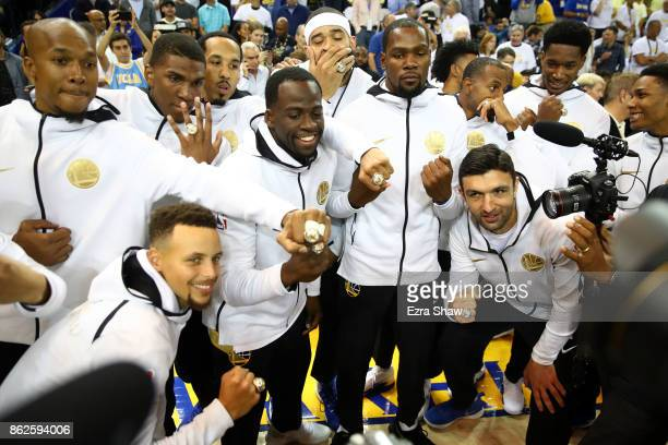 The Golden State Warriors display their 2017 NBA Championship rings prior to their NBA game against the Houston Rockets at ORACLE Arena on October 17...