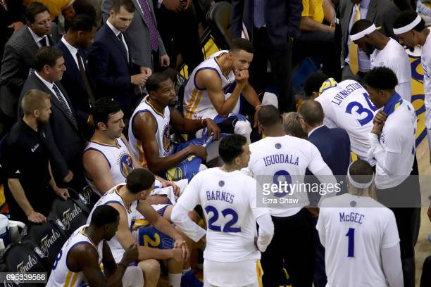 The Golden State Warriors huddle during a timeout in Game 5 of the 2017 NBA Finals against the Cleveland Cavaliers at ORACLE Arena on June 12 2017 in...
