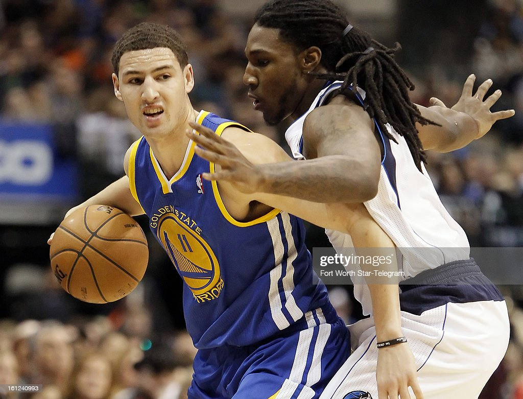 The Golden State Warriors' Klay Thompson (11) works against the Dallas Mavericks' Jae Crowder during the first half at the American Airlines Center in Dallas, Texas, on Saturday, February 9, 2013.