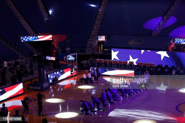 The Golden State Warriors kneel for the National Anthem before their game against the LA Clippers at Chase Center on January 06, 2021 in San...