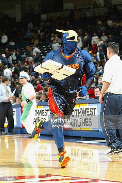 The Golden State Warriors mascot Thunder runs upcourt with a Pizza during a break in the game between the Warriors and the Utah Jazz at The Arena in...