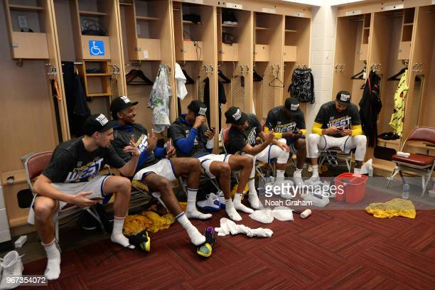 the Golden State Warriors pose for a photo after defeating the Houston Rockets in Game Seven of the Western Conference Finals during the 2018 NBA...