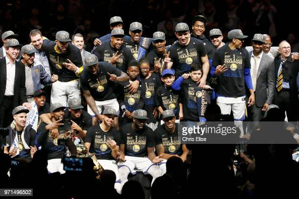 the Golden State Warriors pose with the Larry O'Brien Championship trophy after defeating the Cleveland Cavaliers in Game Four of the 2018 NBA Finals...