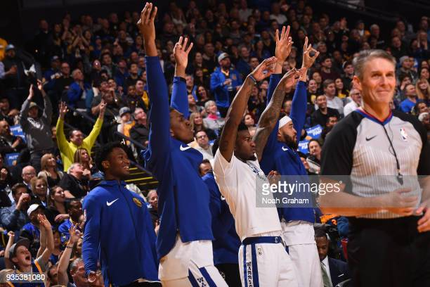 the Golden State Warriors react during the game against the Sacramento Kings on March 16 2018 at ORACLE Arena in Oakland California NOTE TO USER User...