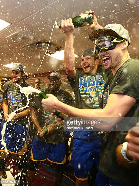The Golden State Warriors react in the locker room after the Golden State Warriors win Game Six of the 2015 NBA Finals against the Cleveland...