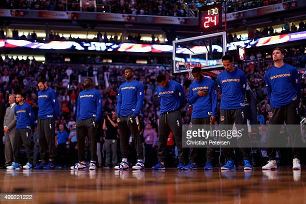 The Golden State Warriors stand attended for the national anthem before the NBA game against the Phoenix Suns at Talking Stick Resort Arena on...