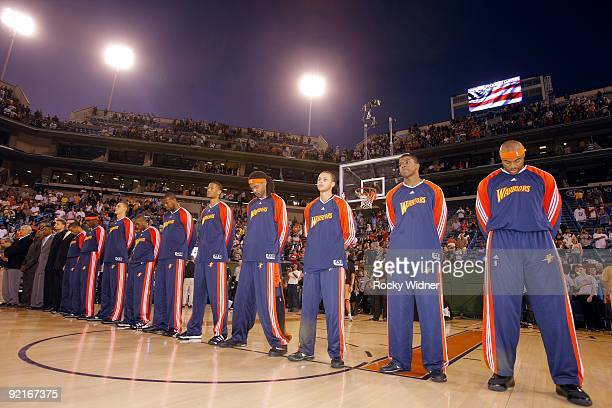 The Golden State Warriors stand for the national anthem prior to the preseason game against the Phoenix Suns at Indian Wells Tennis Garden on October...