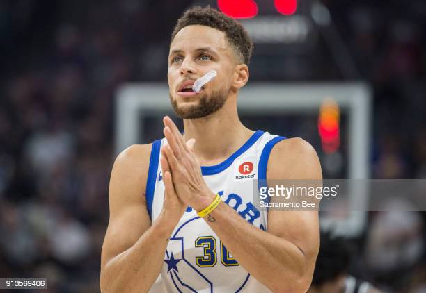 The Golden State Warriors' Stephen Curry looks at the scoreboard as his team trails the Sacramento Kings in the first quarter at Golden 1 Center in...