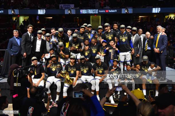 the Golden State Warriors team poses for a photo after defeating the Cleveland Cavaliers in Game Four of the 2018 NBA Finals to become the 2018 NBA...
