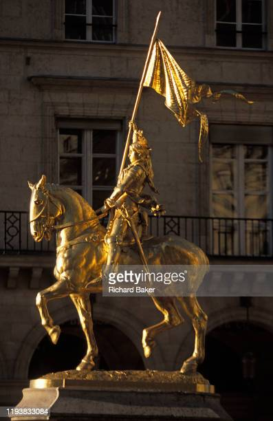 The golden statue of Joan of Arc carrying her banner sparkles in sunshine on 3rd September 2007 in Paris France Jeanne d'Arc is an 1874 French gilded...