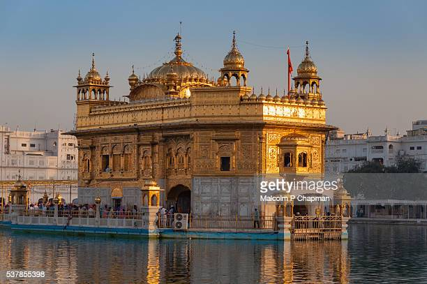 the golden temple, amritsar, india at sunrise - punjab india stock pictures, royalty-free photos & images