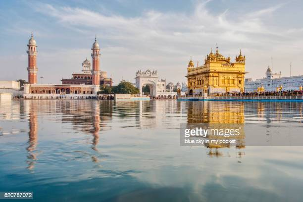 the golden temple at amritsar - golden temple india stock pictures, royalty-free photos & images