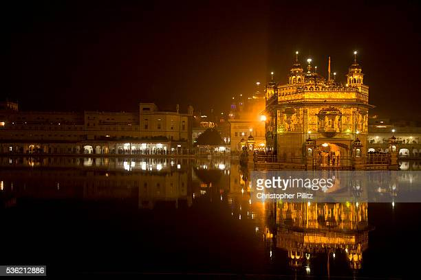 The Golden Temple at night Sikhism's holiest of Gudwaras places of worship Amritsar Punjab India