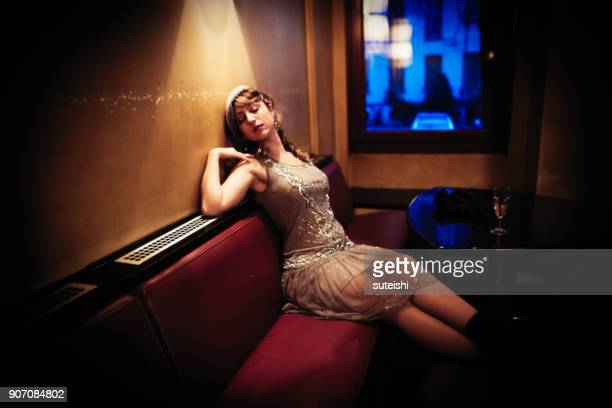 the golden twenties – belle is sleeping in the bar - roaring 20s party stock photos and pictures