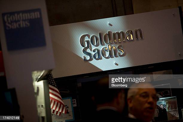 The Goldman Sachs Co logo is displayed at the company's booth on the floor of the New York Stock Exchange in New York US on Friday July 19 2013 US...