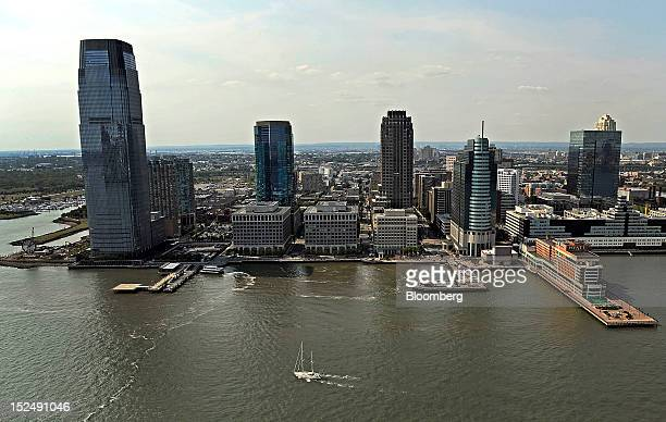 The Goldman Sachs Tower left stands in Jersey City New Jersey US on Monday Sept 17 2012 Goldman Sachs Tower located at 30 Hudson Street is the...