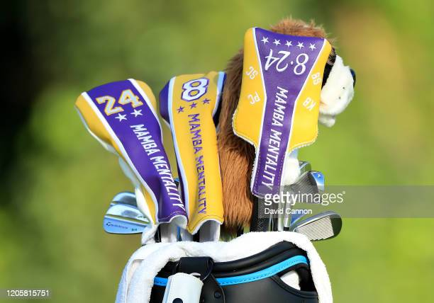 The golf bag of Rory McIlroy of Northern Ireland beside a green showing the special head covers for his metal woods and putter remembering Kobe...