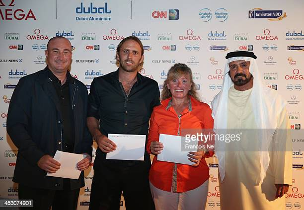 The Golf Citizen 2013 UAE Series grand final winner Carmine Parigi Barry Pavic Ornella Parigi and Mohamed Juma Buaimaim the Vice Chairman and CEO of...