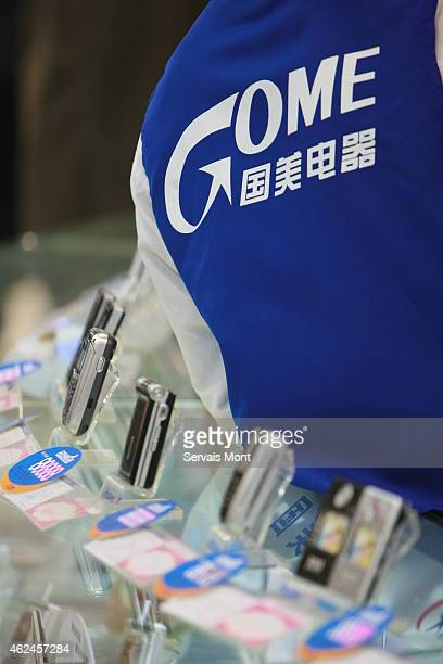 The Gome's logo is seen on a vendor's jacket by mobile phones on sale in a Gome Electrical Appliance store on January 20 2006 in Beijing China
