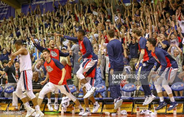 The Gonzaga Bulldogs bench and fans celebrate a score during the second half of the game against the Arizona Wildcats at the Lahaina Civic Center on...
